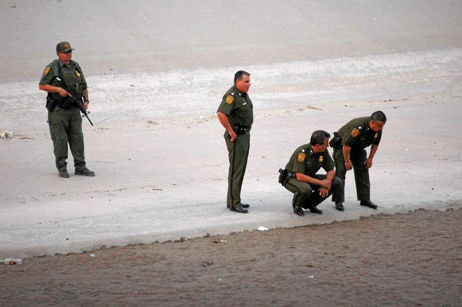 FILE - In this June 7, 2010, file photo, U.S. border patrol agents examine the area near where 14-year-old Mexican youth Sergio Adrian Hernandez Huereca was killed, allegedly shot by a U.S. Border Patrol agent after a confrontation under the Paso Del Norte border bridge in Ciudad Juarez, Mexico. The Border Patrol's parent agency decided to continue allowing agents to use deadly force against rock-throwers and assailants in vehicles, despite recommendations of a government commissioned review to end the practice.  (AP Photo/File) Photo: AP / AP