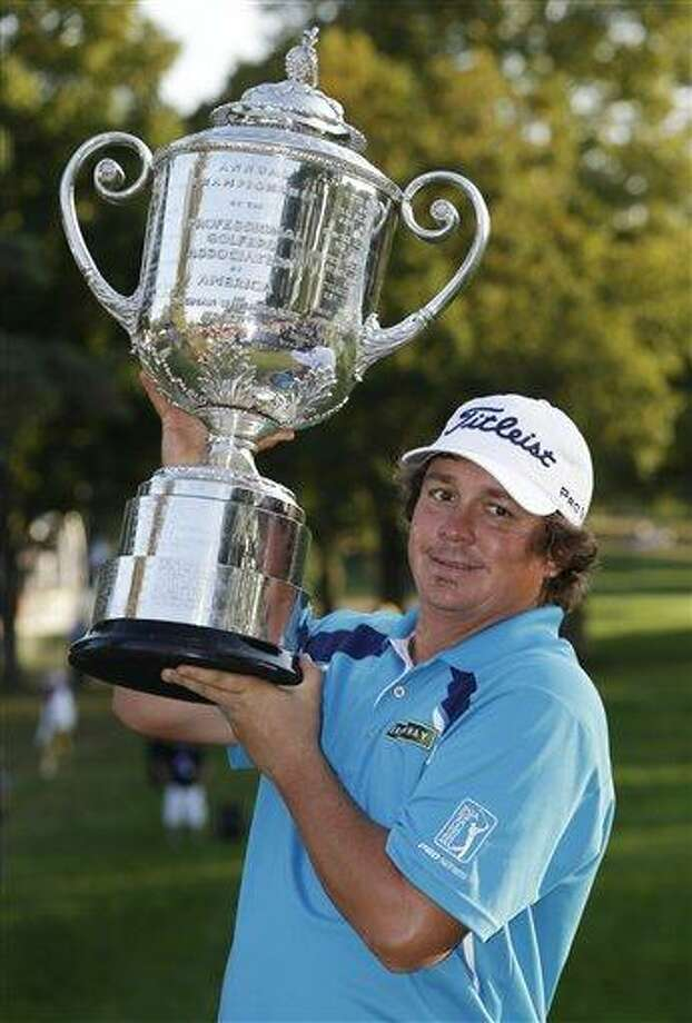 Jason Dufner holds up the Wanamaker Trophy after winning the PGA Championship golf tournament at Oak Hill Country Club, Sunday, Aug. 11, 2013, in Pittsford, N.Y. (AP Photo/Julio Cortez) Photo: AP / AP