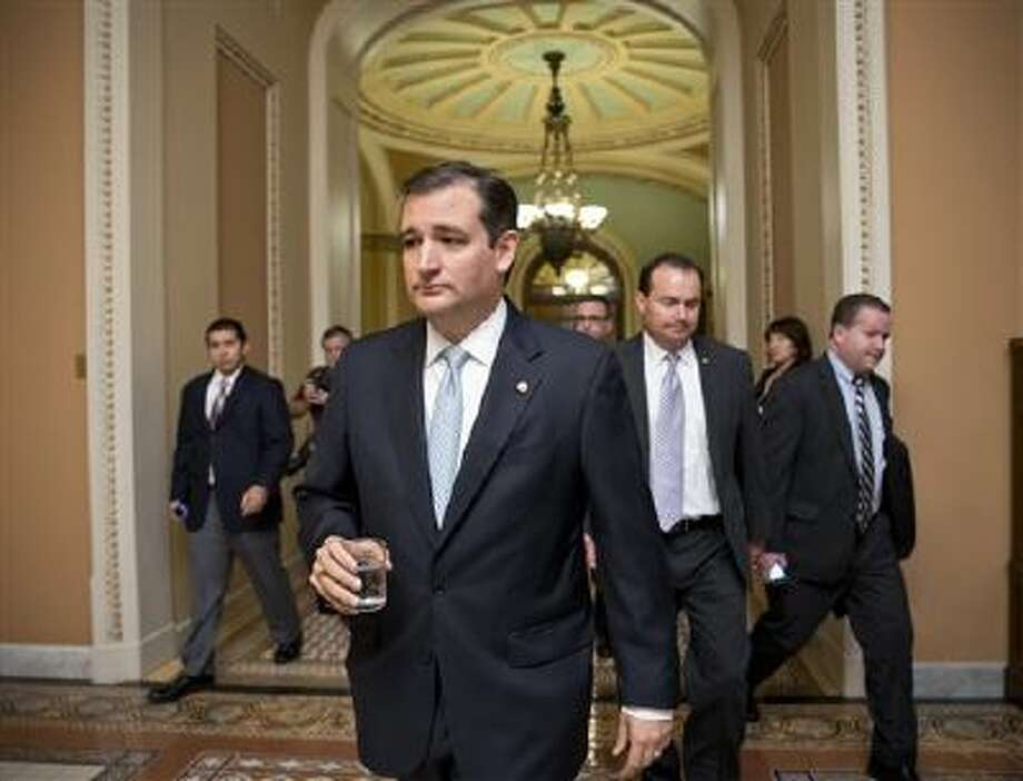 Tea party conservatives Sen. Ted Cruz, R-Texas, and Sen. Mike Lee, R-Utah, right, walk to a meeting Oct. 16. Photo: AP / AP