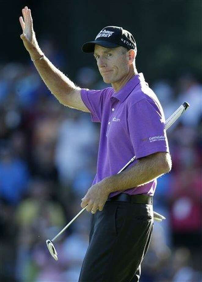 Jim Furyk celebrates after a birdie on the 18th hole during the third round of the PGA Championship golf tournament at Oak Hill Country Club, Saturday, Aug. 10, 2013, in Pittsford, N.Y. (AP Photo/Charlie Neibergall) Photo: AP / AP