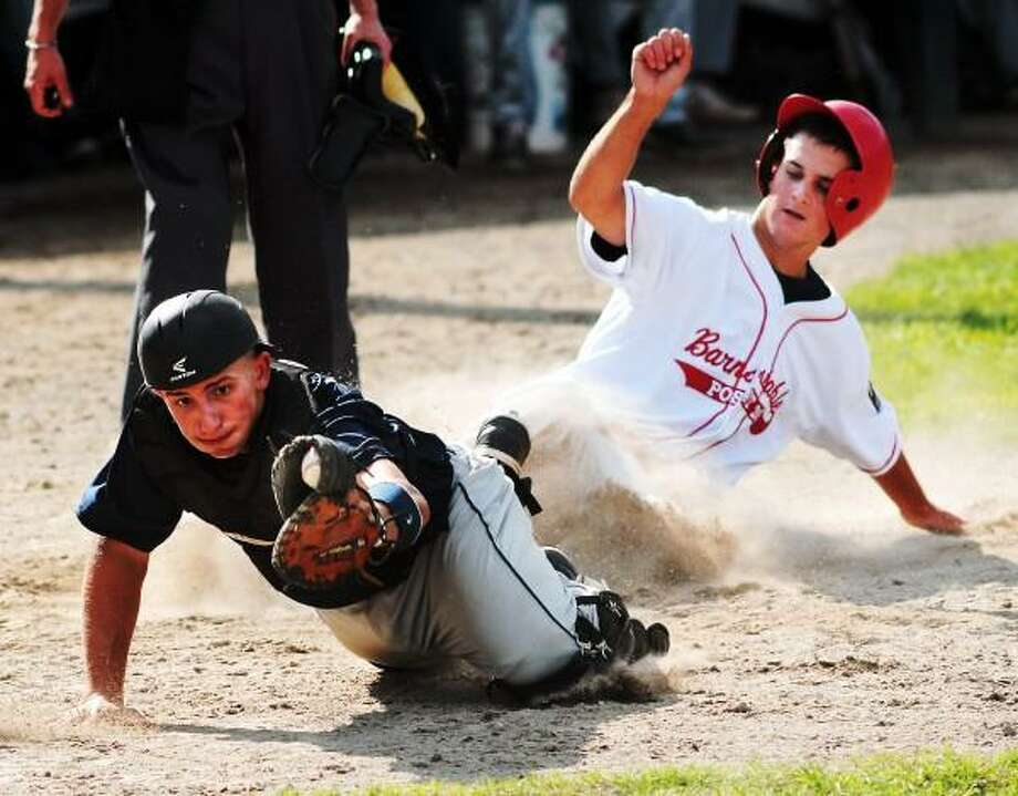 Branford's Alexander Pantani reaches but can't keep it as Barnstable's Spencer McCaffrey slides in. Photo by Mara Lavitt - New Haven Register