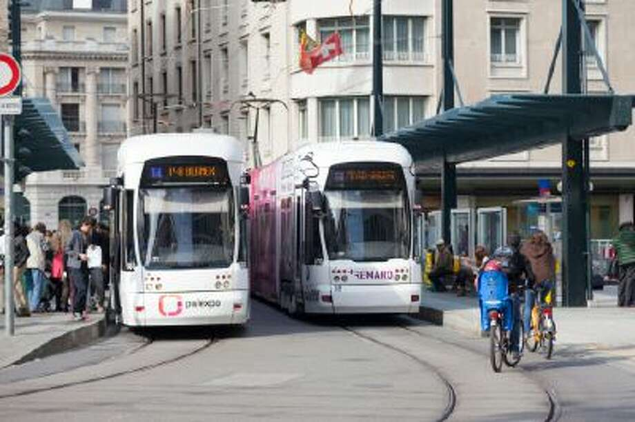 Public tram in Geneva old town Photo: Getty Images/Lonely Planet Image / Lonely Planet Images
