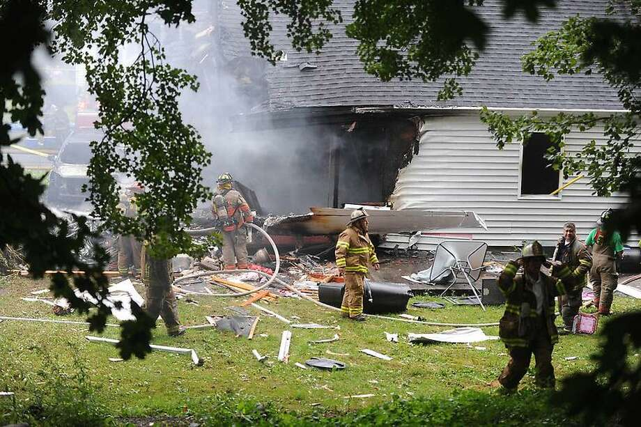 Plane crash in to a house at 64 Charter Oak St in East Haven Friday August 9, 2013 .vmWilliams Ñ Register