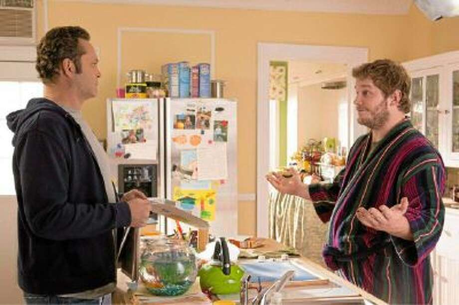 "Vince Vaughn (as David Wozniak) and Chris Pratt (as Brett) star in Walt Disney Pictures' ""Delivery Man."""
