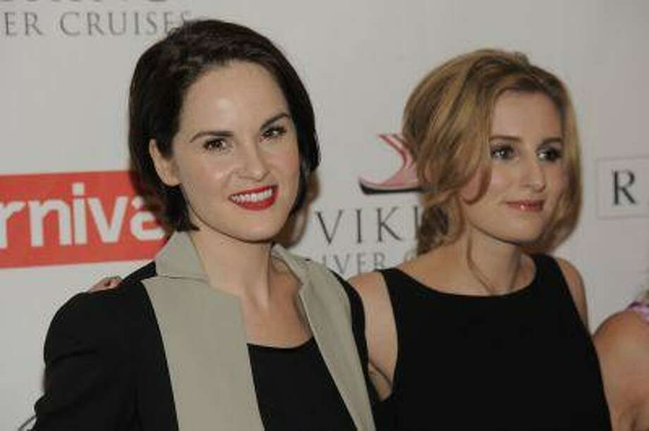 "Michelle Dockery, left, and Laura Carmichael, cast members in the Masterpiece series ""Downton Abbey,"" pose together at the PBS Summer 2013 TCA press tour at the Beverly Hilton Hotel on Tuesday, Aug. 6, 2013 in Beverly Hills, Calif. (Chris Pizzello/Invision/AP) Photo: Chris Pizzello/Invision/AP / AP2013"