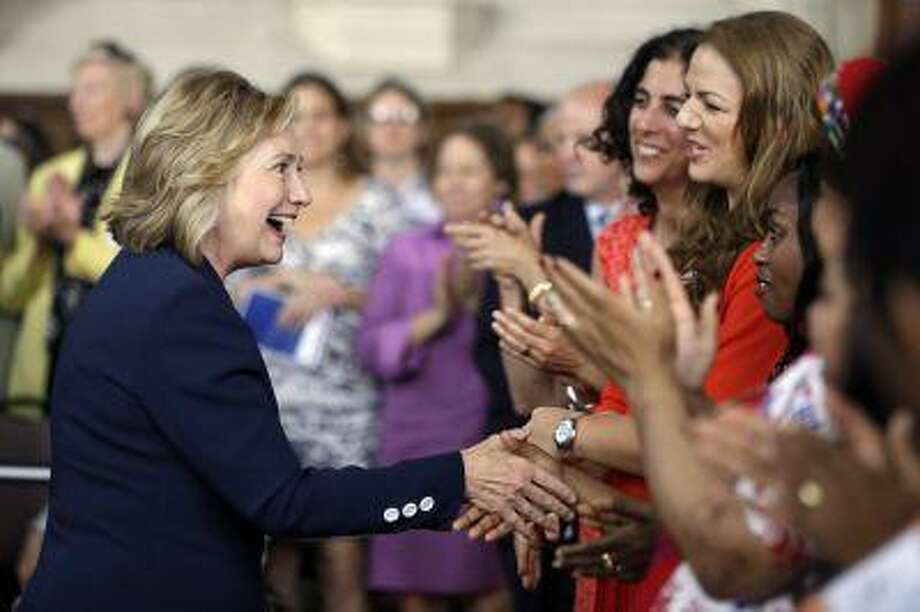 Former Secretary of State Hillary Clinton meets with international delegates at the Women in Public Service Project leadership symposium, Tuesday, July 9, 2013, at Bryn Mawr College in Bryn Mawr, Pa. Photo: ASSOCIATED PRESS / AP2013