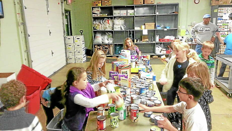 The kids of Create for a Heart, a club at Spencer School, bring the food they collected to Amazing Grace in Middletown. Photo: Submitted Photo