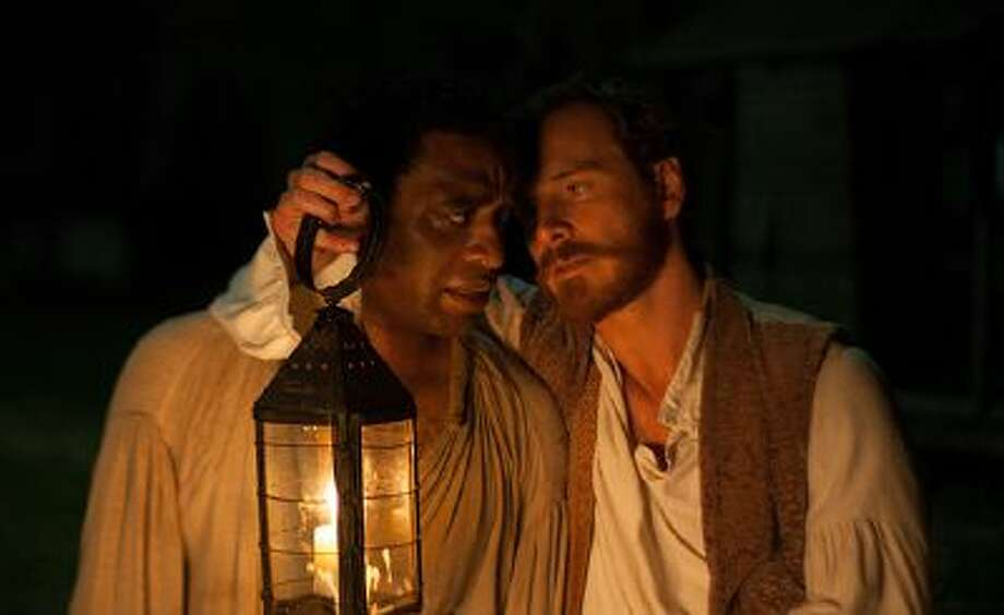 "Chiwetel Ejiofor and Michael Fassbender in ""12 Years a Slave,"" a searing adaptation of the true-life account of a free black man who was kidnapped and sold into slavery. / © 2013 - Fox Searchlight Pictures"