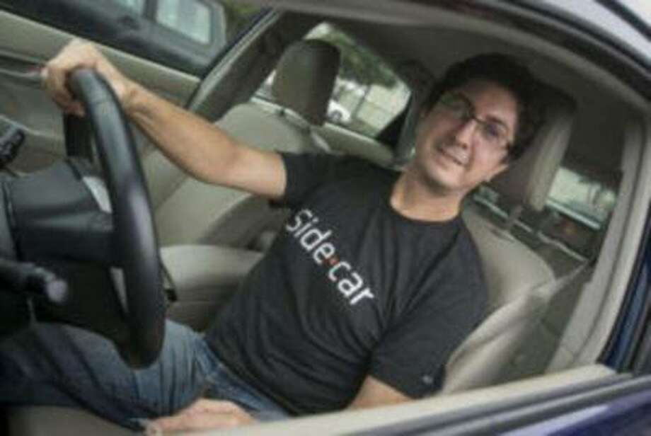 Phillip Zakhour, 49, of San Francisco drives for both TaskRabbit and SideCar. (John Green/Mercury News) Photo: JOHN GREEN / Bay Area News Group