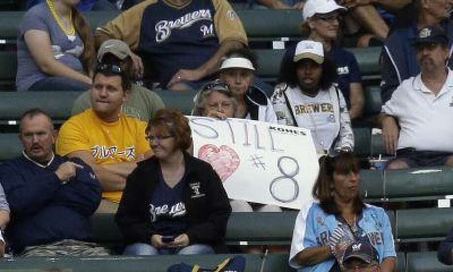 A fan holds up a sign to show her support for Milwaukee Brewers' Ryan Braun before a baseball game against the San Diego Padres on Tuesday, July 23, 2013, in Milwaukee. Photo: AP / AP