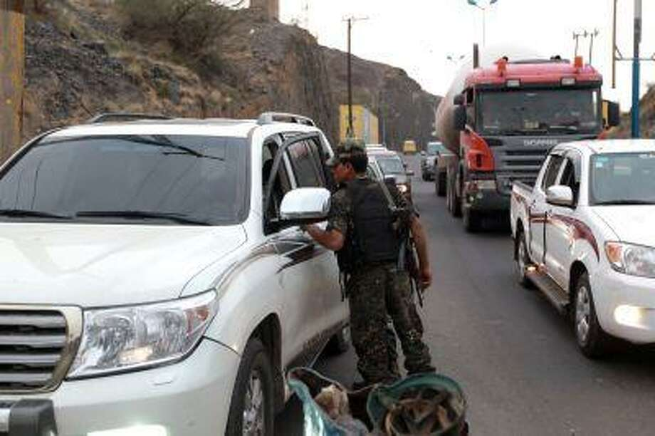 A Yemeni soldier searches a car at a checkpoint in Sanaa, on July 21, 2013, as authorities tighten security measures after gunmen suspected of being members of Al-Qaeda kidnapped an Iranian diplomat in broad daylight in the Yemeni capital, according to police. Photo: AFP/Getty Images / 2013 AFP