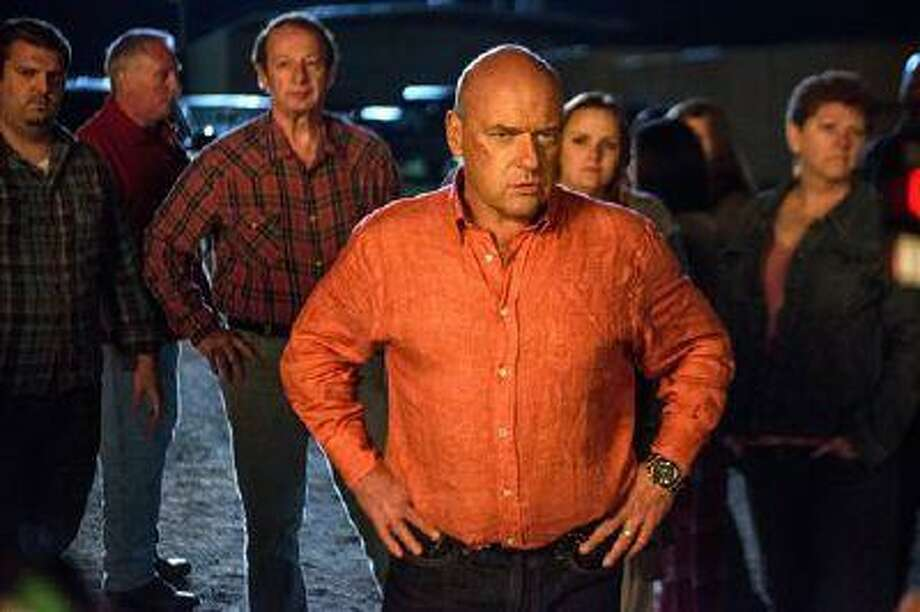 """This publicity image released by CBS shows Dean Norris as James """"Big Jim"""" Rennie, a town leader on the series """"Under the Dome,"""" airing Mondays at 10 p.m. on CBS. Norris will also appear in the final season of the hit series """"Breaking Bad,"""" premiering Sunday at 9 p.m. EST on AMC. Photo: AP / CBS"""