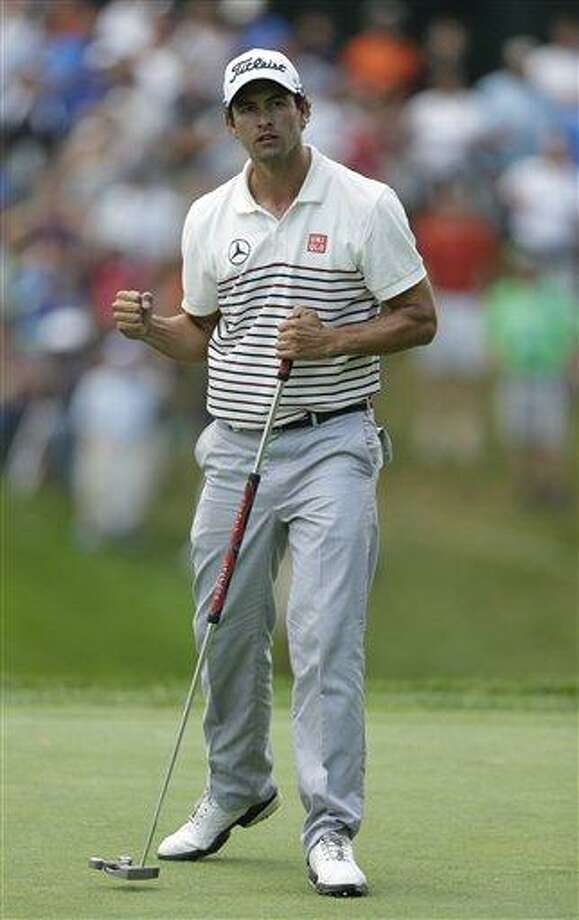Adam Scott, of Australia, reacts after making a birdie putt on the 18th hole during the first round of the PGA Championship golf tournament at Oak Hill Country Club, Thursday, Aug. 8, 2013, in Pittsford, N.Y. (AP Photo/Charlie Neibergall) Photo: AP / AP