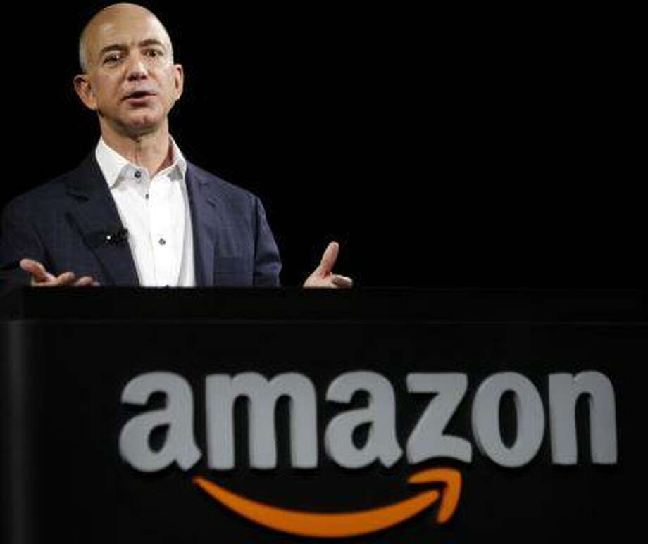 Amazon.com Inc. CEO Jeff Bezos, who paid $250 million to buy The Washington Post, introduces the Kindle Fire HD tablets at a news conference in Santa Monica, Calif., last September. (Patrick Fallon/Bloomberg) Photo: BLOOMBERG NEWS / BLOOMBERG NEWS