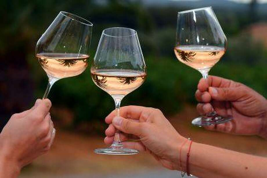 According to Nielsen, sales of rosé table wine costing more than $7.99 a bottle were up more than 21 percent by volume for the 52 weeks ending May 25, compared with the previous 52 weeks. Photo: AFP/Getty Images / 2012 AFP