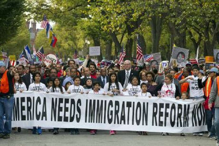 Demonstrators march towards on Capitol Hill during a immigration rally in Washington on Oct. 8, 2013, seeking to push Republicans to hold a vote on a stalled immigration reform bill.