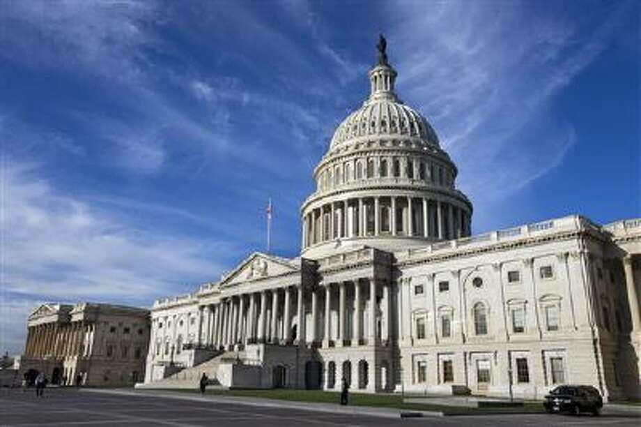 Blue skies set a backdrop for the US Capitol. Photo: AP / AP