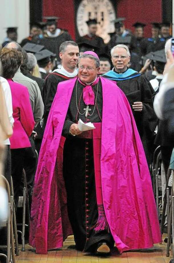 Catherine Avalone/The Middletown Press Bishop Michael Cote leads the recessional at the forty-seventh commencement exercises at Xavier High School. / TheMiddletownPress