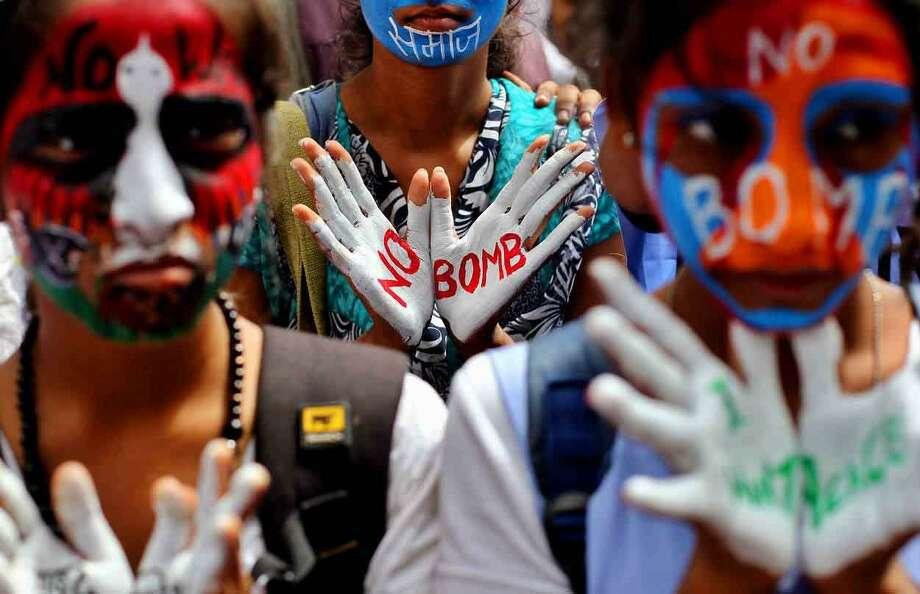 "Indian students with their faces painted in colors, participate in a Hiroshima Day peace rally in Mumbai, India, Tuesday, Aug. 6, 2013. Tuesday marked the 68th anniversary of the world's first atomic bombing that killed as many as 140,000 people. A face, center, is painted with letters that read: ""Society."" (AP Photo/Rafiq Maqbool) Photo: ASSOCIATED PRESS / THE ASSOCIATED PRESS2013"
