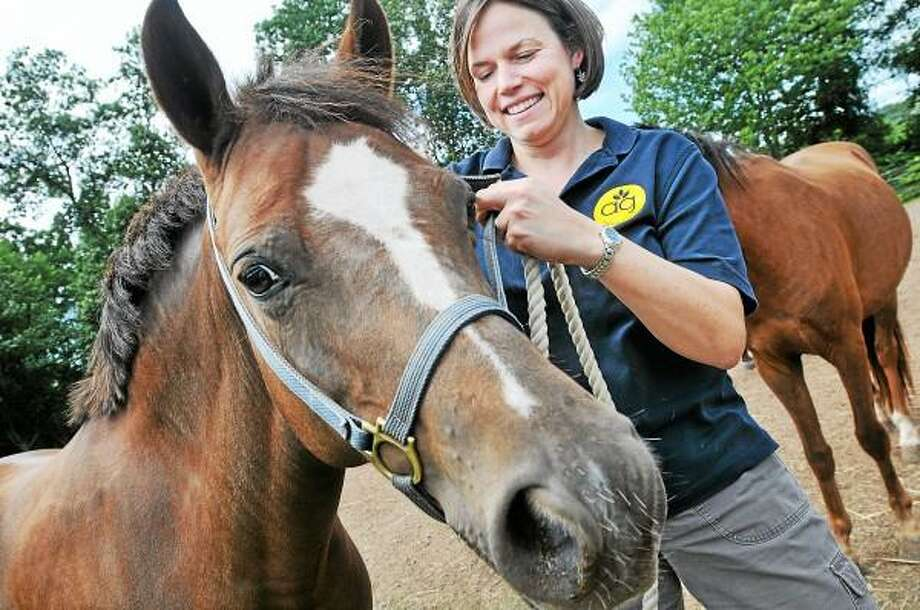 Amanda Thomson, an animal science teacher at Middletown High School won the Outstanding Teacher Award for Region 6 from the National Association of Agriculture Educators. Thomson is photographed with Royal Belle, a Welsh pony at Epic Farm on Cherry Hill Road in Middlefield. Epic Farm is an agricultural partner with Middletown High School's Agriculture, Science & Technology program. / TheMiddletownPress