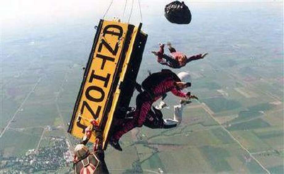 In this undated photo released by Anthony Martin, escape artist Anthony Martin of Sheboygan, Wis., escapes from a wooden box that was locked and pushed out of a plane at 13,500 feet in August 1988, in Sandwich, Ill. (Courtesy of Anthony Martin/AP) Photo: AP / Courtesy of Anthony Martin