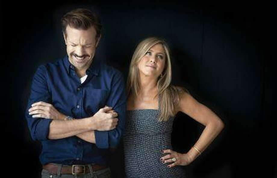 "FILE - In this July 27, 2013 file photo, actor Jason Sudeikis, left, and actress Jennifer Aniston pose for a portrait as they promote the movie ""We're the Millers"" in New York. The film opens nationwide on Wednesday, Aug. 7. (Photo by Carlo Allegri/Invision/AP, File) Photo: Carlo Allegri/Invision/AP / Invision"