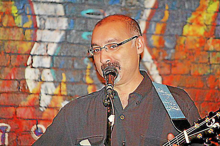 Submitted photo - Courtesy of the musicianKumar Ramanan playing for Feed the People at Black-eyed Sally's Photo: Journal Register Co.
