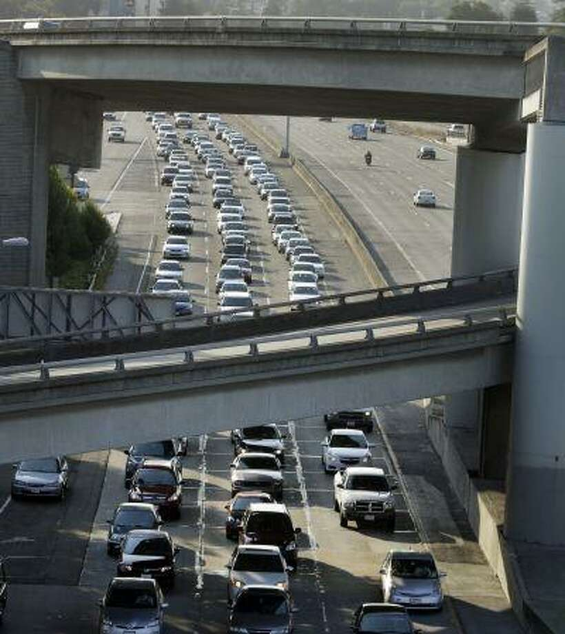 Commuters wait in traffic on Interstate 80 on approach to the San Francisco-Oakland Bay Bridge Monday, July 1, 2013, in Oakland, Calif. (AP Photo/Ben Margot) Photo: AP / AP