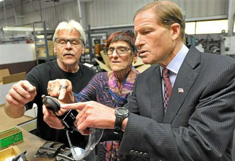 Portland resident John Sullivan, a toolmaker at Pegasus Manufacturing explains how he tools a gauge for a turbine engine to Congresswoman Rosa DeLauro and Senator Richard Blumenthal during a tour of the 52,000 square foot Middletown facility Tuesday morning. Congresswoman DeLauro introduced the Manufacturing Reinvestment Account (MRA) Act in April and Senator Blumenthal will be introducing the Senate version in the fall. Catherine Avalone - The Middletown Press / TheMiddletownPress