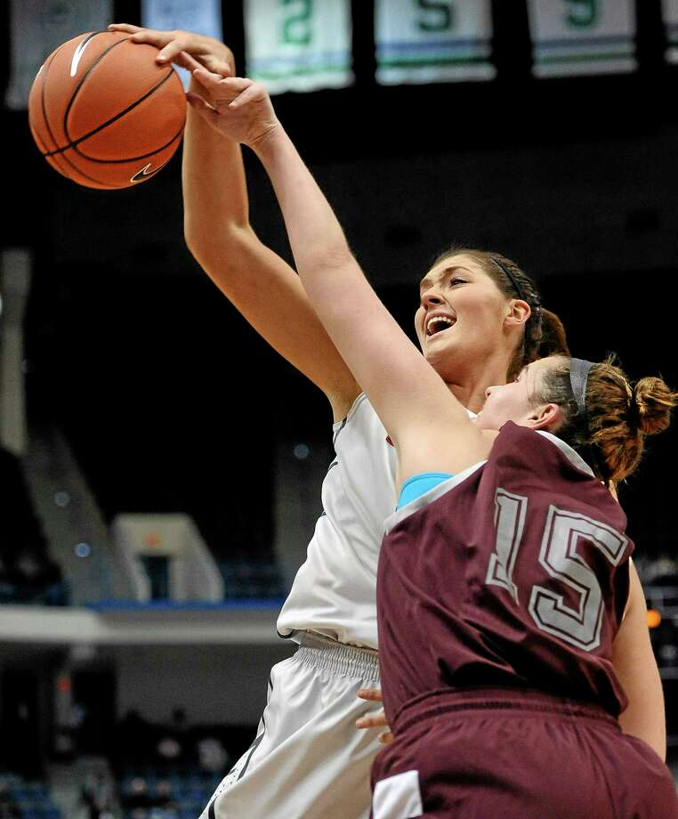 Stefanie Dolson and UConn had no trouble with Tori Arnao and Philadelphia on Tuesday night at the XL Center in Hartford. The Huskies won their second and final exhibition game 93-28. Photo: Jessica Hill — The Associated Press  / FR125654 AP