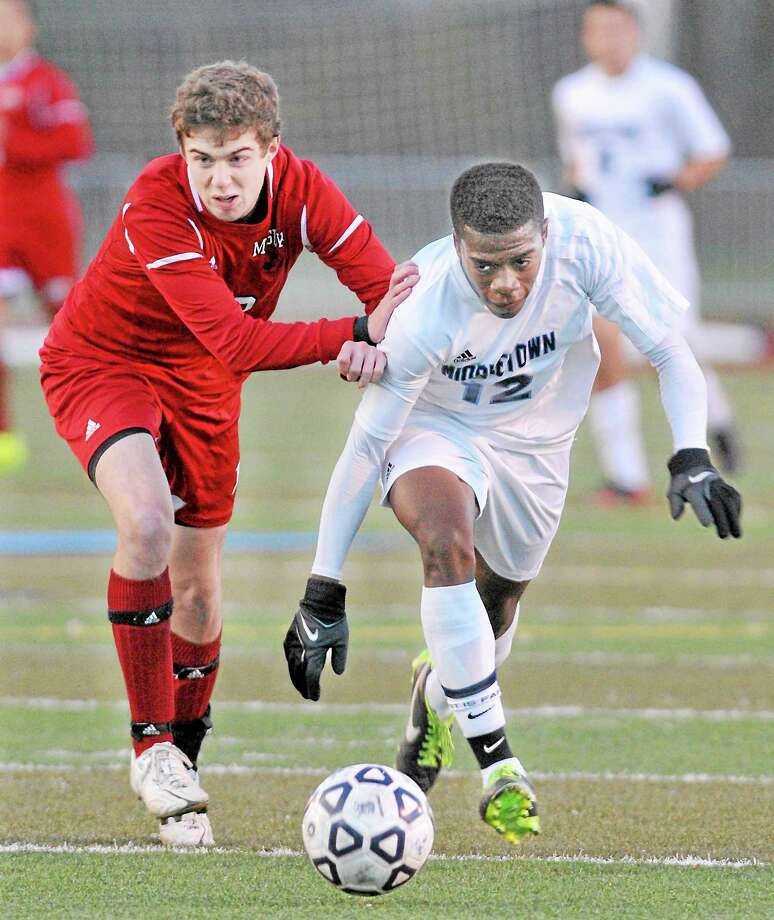 Middletown senior Lucas Saunders drives past Masuk junior Nicholas Zacchilli toward the Masuk goal Tuesday afternoon. Masuk defeated Middletown 2-0 in the CIAC Class L First Round. Photo: Catherine Avalone — The Middletown Press  / TheMiddletownPress