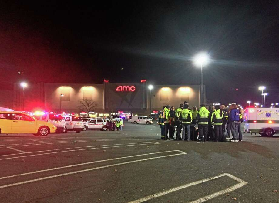 In this photo taken and provided to the AP, which has been authenticated based on its contents and other AP reporting, authorities stand in the parking lot of Garden State Plaza Mall, late Monday, Nov. 4, 2013, in Paramus, N.J., after there were reports of multiple shots being fired inside the mall. (AP Photo/Carlos Sinde) Photo: AP / Carlos Sinde