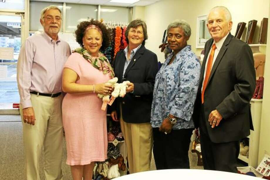 A grand re-opening was held recently for Pamela Roose Specialty Hand Knits at its new business location on Court Street. A graduate of the Chamber's Side Street to Main Street Business & Leadership Development Program, Pam Steele, second from left, previously ran her business from home and from the Main Street Market. From left, Deputy Mayor Bob Santangelo, Steele, Middlesex County Chamber of Commerce Chairwoman Darlene Briggs, Side Street to Main Street coordinator Jennifer De Kine and chamber President Larry McHugh.
