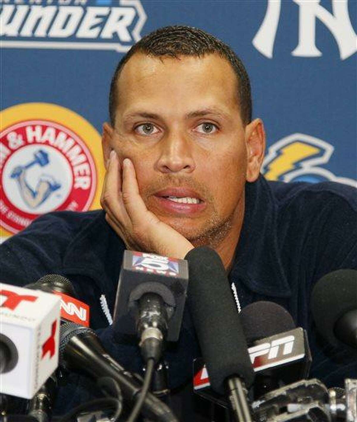 FILE - In this Aug. 2, 2013, file photo, New York Yankees' Alex Rodriguez answers questions from reporters during a news conference following a Class AA baseball game with the Trenton Thunder against the Reading Phillies, in Trenton, N.J. Three MVP awards, 14 All-Star selections, two record-setting contracts and countless controversies later, A-Rod is the biggest and wealthiest target of an investigation into performance-enhancing drugs, with a decision from baseball Commissioner Bud Selig expected on Monday, Aug. 5, 2013. (AP Photo/Tom Mihalek, File)