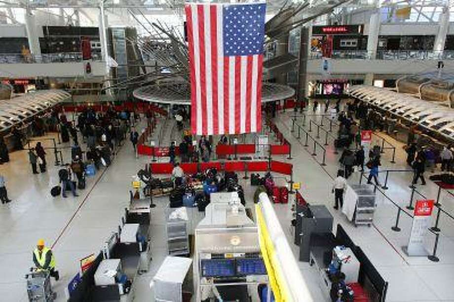 People wait in a security line at John F. Kennedy Airport on February 28, 2013 in New York City. Photo: Getty Images / 2013 Getty Images
