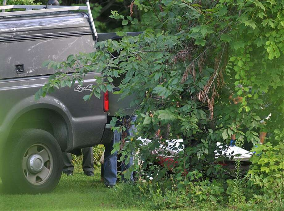 The State Medical Examiner's office prepares to transport the body of the Bristol man found dead in the Coginchaug River Sunday afternoon at Wadsworth Falls State Park in Middlefield. According to State Police Sgt. Sal Calvo, the man, who was not identified, was reportedly climbing the wall area of the falls, slipped on one the rocks and struck his head on the rocks. Catherine Avalone - The Middletown Press / TheMiddletownPress