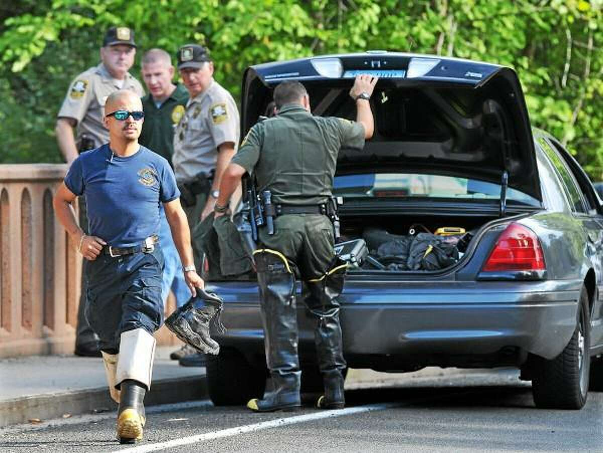 The Department of Energy and Environmental Protection EnCon Police at the scene at the Cherry Hill Road Bridge after a person noticed the body of a man lying face down in the Coginchaug River at around 3:00 p.m. Sunday afternoon at Wadsworth Falls State Park in Middlefield Sunday afternoon. According to State Police Sgt. Sal Calvo, the Bristol man, who was not identified, was reportedly climbing the wall area of the falls, slipped on one the rocks and struck his head on the rocks below. Catherine Avalone - The Middletown Press