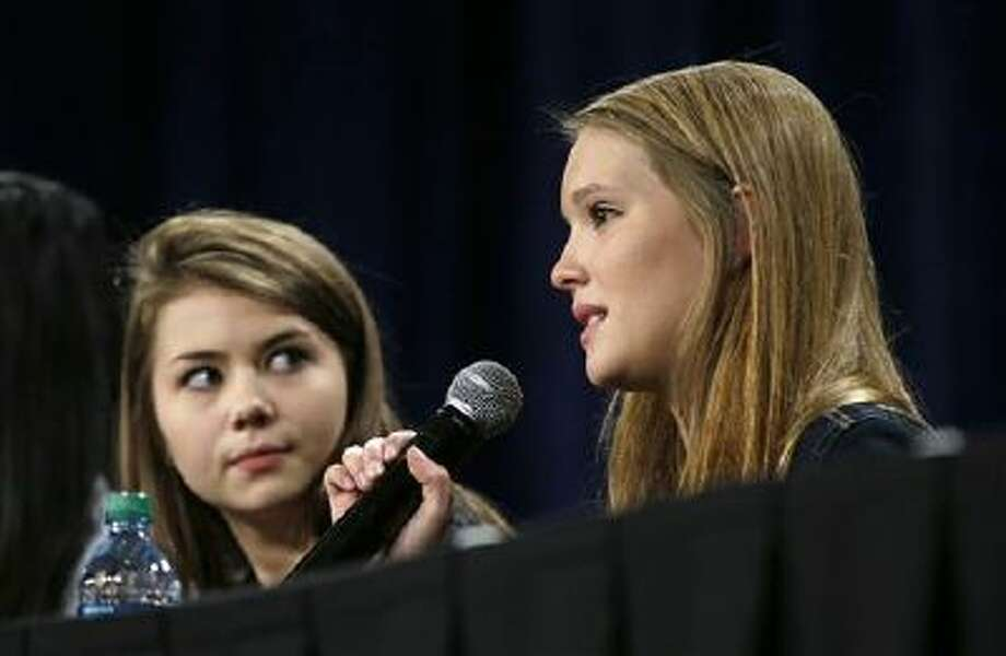 Christina Wagner, of Edina, Minn., right, speaks during Iowa Gov. Terry Branstad's Bullying Prevention Summit as Hayley Reardon, of Marblehead, Mass., looks on Monday in Des Moines, Iowa. Students at Branstad's second anti-bullying summit say that kids can make a difference in preventing harassment. Meanwhile, Utah lawmakers are addressing related parent notification issues. Photo: AP / AP