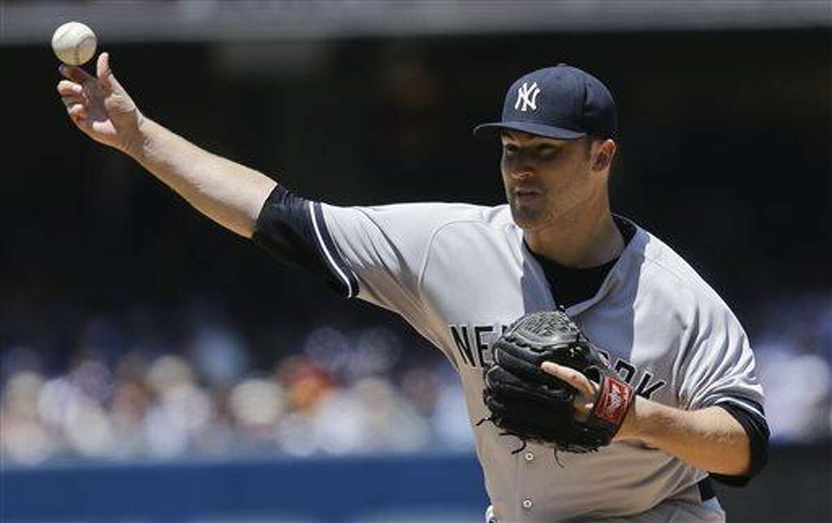 New York Yankees starting pitcher Phil Hughes works against the San Diego Padres in the first inning of a baseball game in San Diego, Sunday, Aug. 4, 2013. (AP Photo/Lenny Ignelzi)