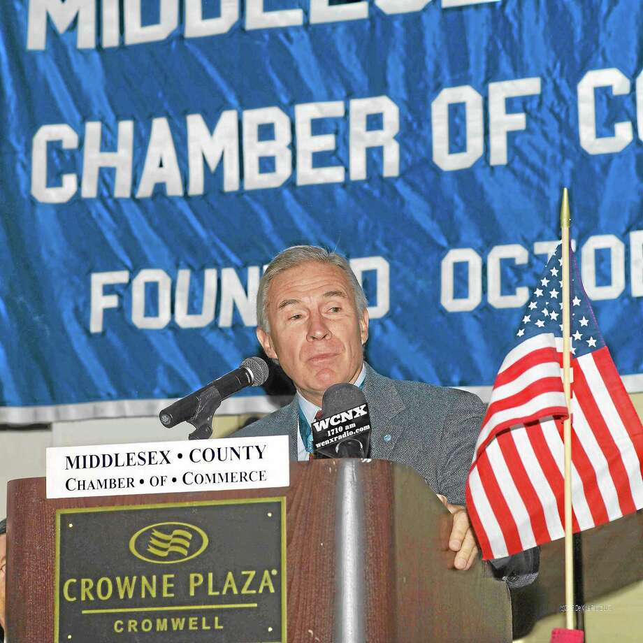 """Former Army Capt. Paul """"Buddy"""" Bucha addresses the crowd at the 12th Annual Support the Troops & Honor the Veterans Member Breakfast Meeting. Photo: De Kine Photo LLC  / Rice Creek Photo"""