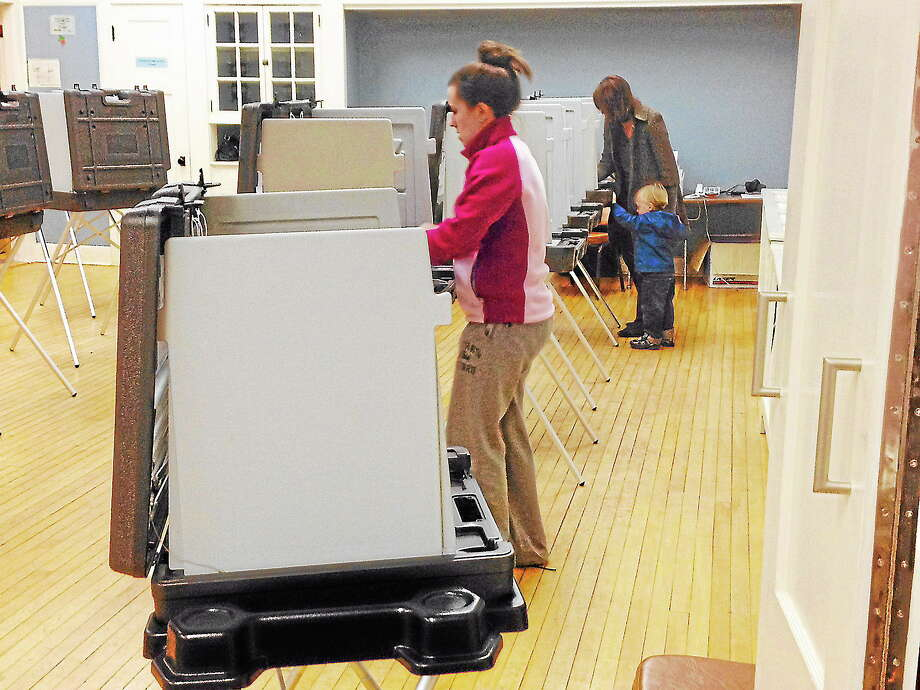 Residents vote at the Middlefield Community Center Tuesday. Photo: Michael T. Lyle Jr. — The Middletown Press