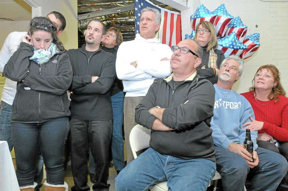 Seb Guiliano, in white sweatshirt surrounded by family and friends, waits at Republican headquarters as election results are read off Tuesday evening. Photo: Catherine Avalone - The Middletown Press   / TheMiddletownPress