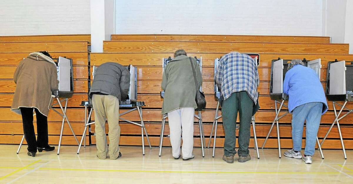 Residents living in District 11 vote at Woodrow Wilson Middle School in Middletown Tuesday.