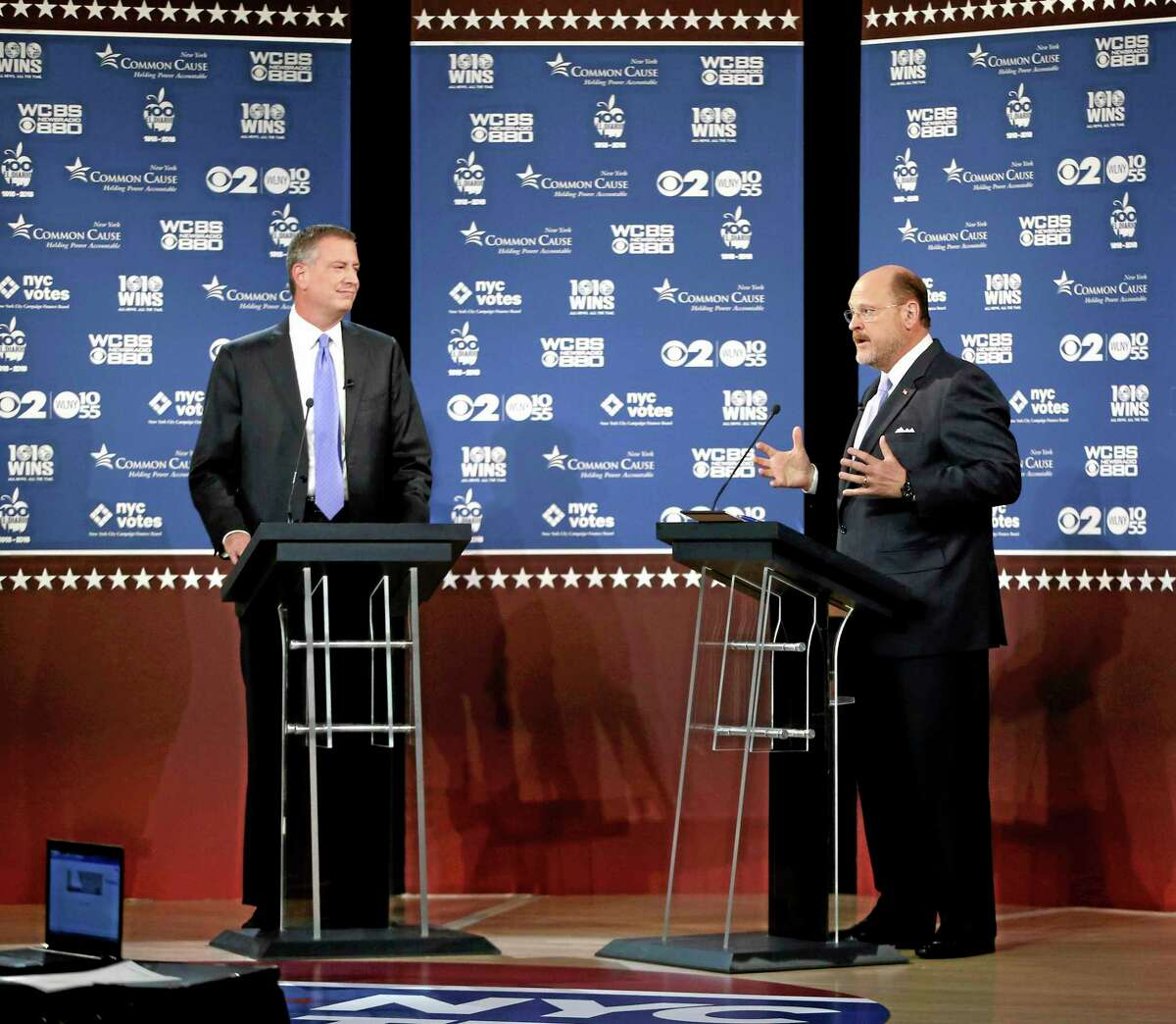 New York City Democratic mayoral candidate Bill de Blasio, left, listens as Republican candidate Joe Lhota makes a point during as they participate in the second of three debates prior to the Nov. 5 general election, Tuesday, Oct. 22, 2013, in New York. (AP Photo/ Kathy Willens, Pool)
