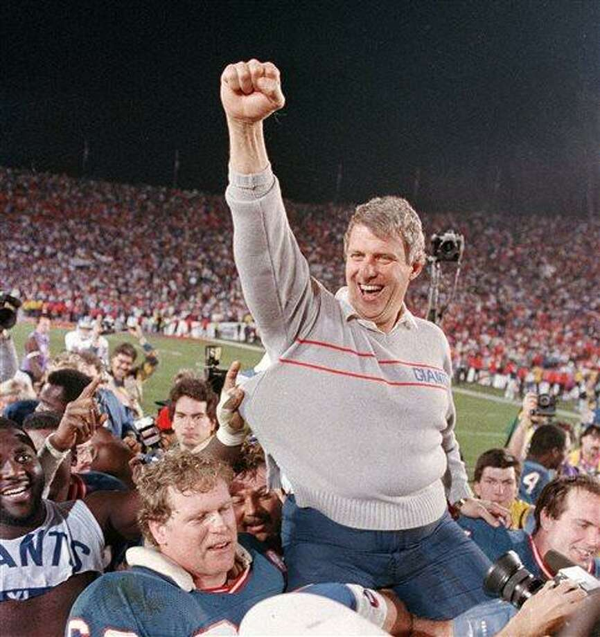 FILE - In this Jan. 25, 1987, file photo, New York Giants coach Bill Parcells is carried off the field after the Giants defeated the Denver Broncos, 39-20, in Super Bowl XXI in Pasadena, Ca. Parcells will enter the Pro Football Hall of Fame in Canton, Ohio, Sunday, Aug. 4, 2013. (AP Photo/Eric Risberg, File) Photo: AP / AP