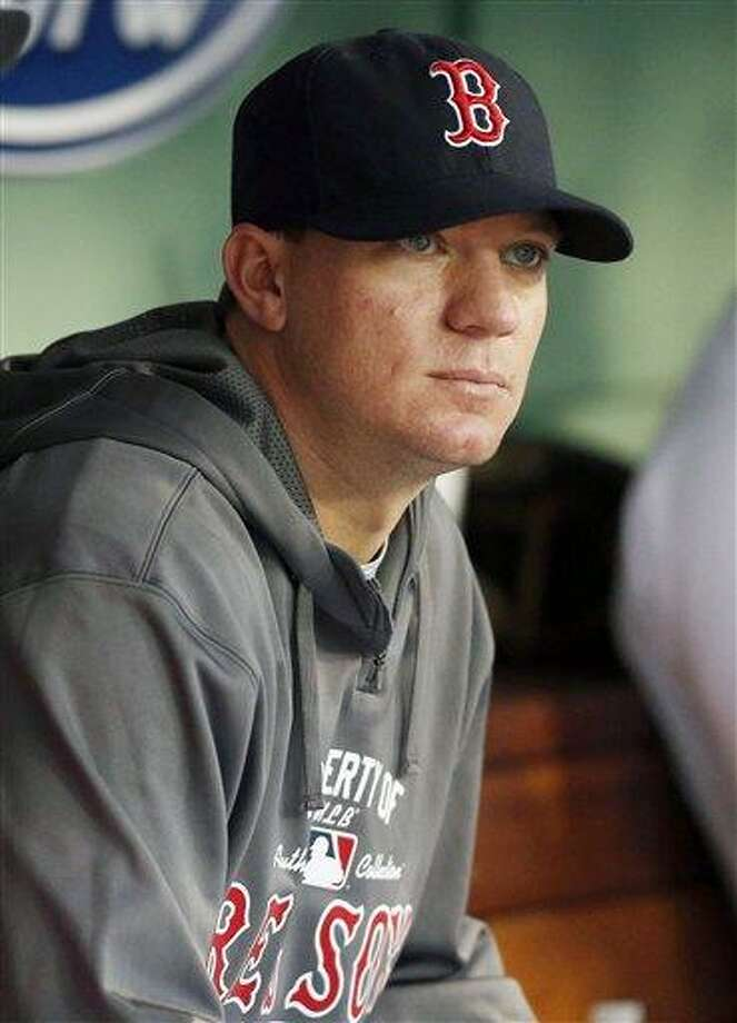 Boston Red Sox's Jake Peavy sits in the dug out before a baseball game against the Seattle Mariners in Boston, Thursday, Aug. 1, 2013. (AP Photo/Michael Dwyer) Photo: AP / AP
