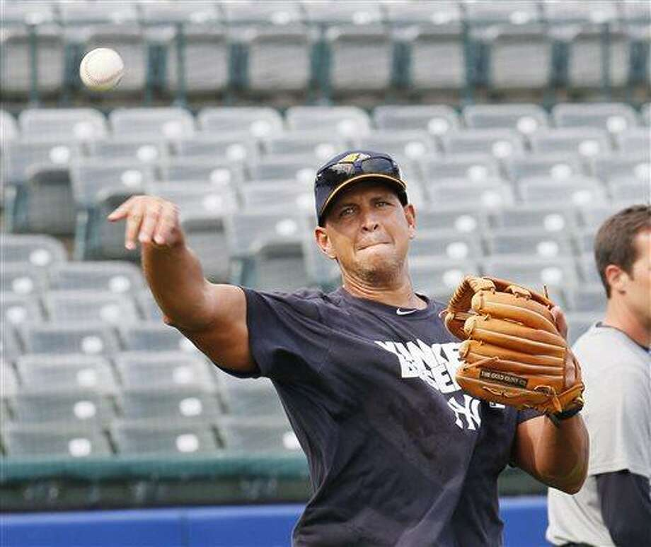 New York Yankees' Alex Rodriguez loosens up before the start of a Class AA baseball game with the Trenton Thunder against the Reading Phillies, Friday, Aug. 2, 2013, in Trenton, N.J. (AP Photo/Tom Mihalek) Photo: AP / FR148949 AP