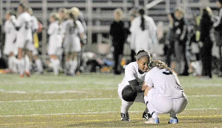 Middletown senior Rajeen Mayor consoles teammate Marissa Aldieri following their 2-1 loss to Bunnell-Stratford in the First Round of the CIAC Class L soccer tournament Monday evening at Rosek-Skubel Stadium at MHS. Photo: Catherine Avalone — The Middletown Press  / TheMiddletownPress