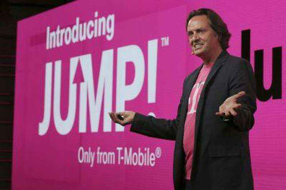 In this Wednesday, July 10, 2013, photo, T-Mobile CEO John Legere speaks during news conference in New York. T-Mobile says it will let people upgrade phones more quickly for a $10 monthly fee. With the new Jump plan, a customer will be able to get a new phone if the old one malfunctions or gets lost, or even if there's a better phone that comes out. The plan lets customers upgrade up to twice a year. Rivals typically allow upgrades after about two years. (AP Photo/Mary Altaffer) Photo: ASSOCIATED PRESS / AP2013