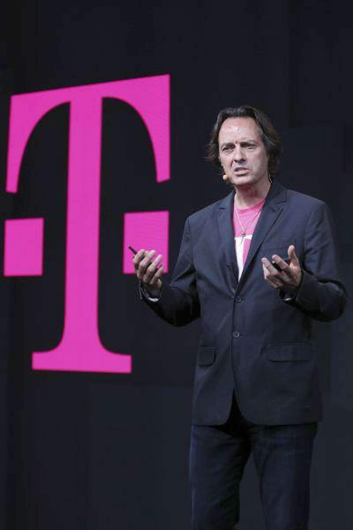 T-Mobile CEO John Legere speaks during news conference, Wednesday, July 10, 2013 in New York. (AP Photo/Mary Altaffer)